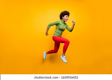 Full length body size view of her she nice attractive lovely girlish cheerful cheery wavy-haired girl jumping running activity isolated over bright vivid shine vibrant yellow color background