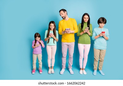 Full length body size view of nice attractive lovely addicted big full family using app 5g wi-fi connection isolated on bright vivid shine vibrant blue color background