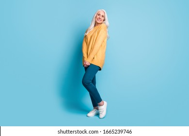 Full length body size view of her she nice-looking attractive lovely charming cheerful cheery grey-haired woman posing wearing casual isolated over bright vivid shine vibrant blue color background