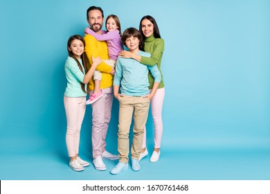 Full length body size view of nice attractive lovely adorable tender sweet gentle cheerful cheery family teenage hugging growing-up isolated on bright vivid shine vibrant blue color background