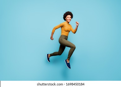 Full length body size view of nice lovely healthy cheerful active confident strong wavy-haired girl running having fun isolated on bright vivid shine vibrant blue green teal turquoise color background