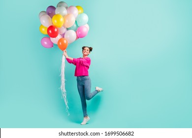 Full length body size view of nice attractive dreamy cheerful cheery wavy-haired girl holding in hand air balls having fun isolated on bright vivid shine vibrant green blue color background