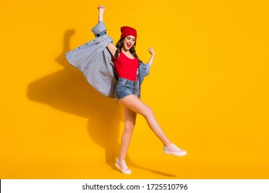 Full length body size view of her she nice attractive slender glamorous cheerful cheery glad wavy-haired girl dancing enjoying having fun isolated on bright vivid shine vibrant yellow color background