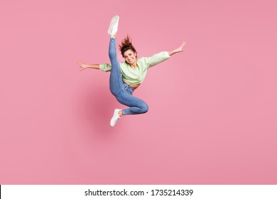 Full length body size view of her she nice attractive slender energetic cheerful cheery girl jumping making doing pirouette exercise having fun practicing isolated over pink pastel color background
