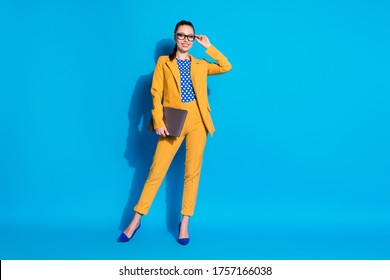 Full length body size view of her she nice-looking attractive classy chic gorgeous lady leader shark touching specs holding in hand laptop isolated bright vivid shine vibrant blue color background
