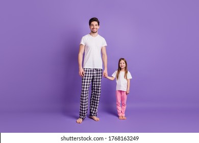 Full length body size view of her she his he nice lovely cheerful dad daughter holding hands wearing pijama isolated on bright vivid shine vibrant violet color background