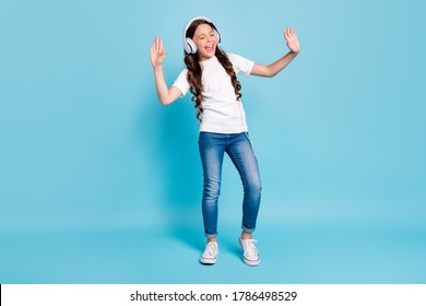 Full length body size view of nice dreamy cheerful wavy-haired girl listening stereo single melody having fun dancing isolated on bright vivid shine vibrant blue teal turquoise color background