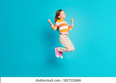 Full length body size view of her she nice attractive cheery cheerful glad lucky girl jumping celebrating having fun isolated over bright vivid shine vibrant blue color background