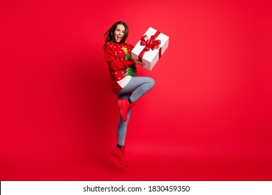 Full length body size view of her she nice attractive pretty glad cheerful girl jumping having fun holding in hands giftbox 14 February isolated bright vivid shine vibrant red color background