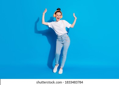 Full length body size view of her she nice attractive pretty dreamy cheerful cheery girl listening melody pop soul jazz bass having fun isolated on bright vivid sine vibrant blue color background