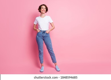 Full length body size view of attractive cheery brown-haired girl thinking copy space isolated over pink pastel color background