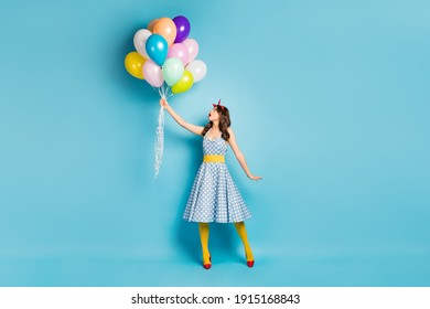 Full length body size view of her she nice-looking attractive lovely pretty amazed wavy-haired girl holding air balls flying up isolated on bright vivid shine vibrant blue color background