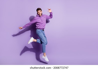 Full length body size view of attractive funny cheerful guy jumping having fun isolated over purple violet color background - Shutterstock ID 2008772747