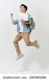 Full length body size of young Asian student man jumping in air using laptop with backapck isolated over white color background