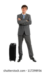 Full length of business man standing near luggage isolated on white background