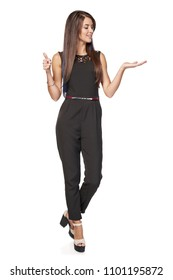Full length business woman showing holding on the palm blank copy space and gesturing thumb up, over white background