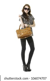 Full length casual young fashion holding bag posing