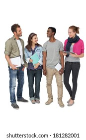 Full length of casual young people with documents and digital table over white background