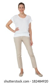 Full length of a casually dressed young woman over white background