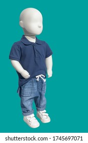 Full length child mannequin dressed in casual kids wear, isolated on green background. No brand names or copyright objects.