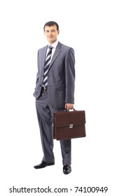 Full length of a confident business man with hands folded isolated against white
