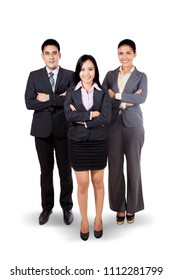 Full length of confident business team smiling at the camera while standing in the studio, isolated on white background