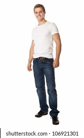 Full length of a cute young man in jeans and t-shirt looking at the camera, against white background
