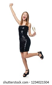 Full length excited girl in sequined dress jumping of joy with a glass of champagne looking aside, over white background