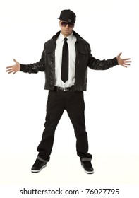 Full length front view of young adult hip hop male on white background.