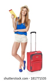 Full length funky teen girl in shorts and straw hat standing with travel bag, holding tickets, isolated on withe background