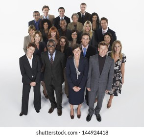 Full length group portrait of multiethnic businesspeople against white background