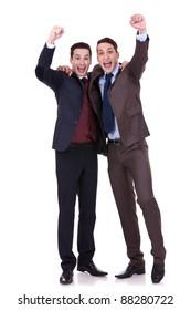 Full length of handsome two business men winning on hite background