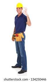 full length of handyman giving ok sign on white