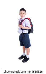 Full length of happy asian schoolboy wearing uniform and smiling over white background