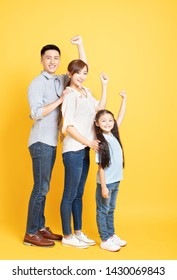 full length of Happy asian young Family