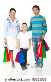 Full length of happy family with colorful shopping bags