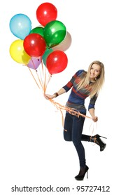 Full length of a happy woman holding balloons against white background