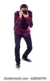 Full length of a happy  young photographer taking a picture, guy wearing red caro shirt and jeans, isolated on white background