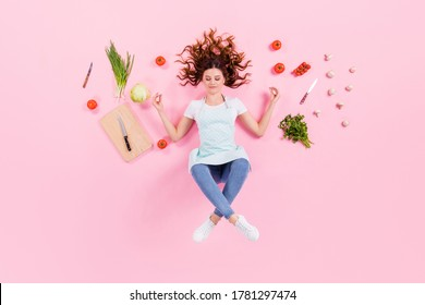 Full length high angle top above flat lay view photo of pretty housewife lady lying floor morning yoga meditation wear kitchen apron cooking utensils cuisine isolated pink color background - Shutterstock ID 1781297474