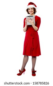 Full length image of female santa with tablet pc