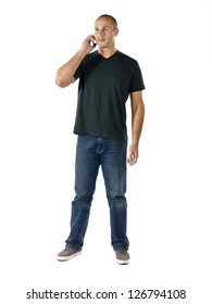A full length image of a gorgeous man using a cell phone over the white background