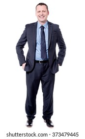 Full length image of male executive with hands in pockets