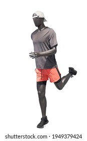 Full length image of a running male display mannequin wearing sportswear isolated on a white background.