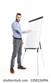 Full length image of Smiling bearded elegant man in eyeglasses making presentation while using flipchart and looking at the camera over grey background