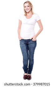 Full length image of young woman with hands in pockets