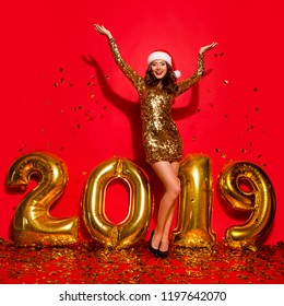 Full length, legs, body, size portrait of careless, carefree, dream, dreamy lady on sharp, pumps, stilettos with modern wave hairstyle isolated on bright red background rejoice and raised hands up