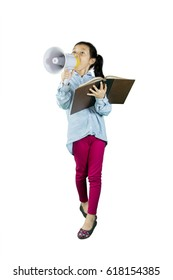 Full length of little student speaking on megaphone while holding a book, isolated on white background