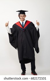 full length of the malay graduated student looking at camera