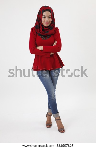 full length of malay woman with red tudung cross arm