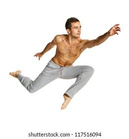 Full length of a male hero flying against white background